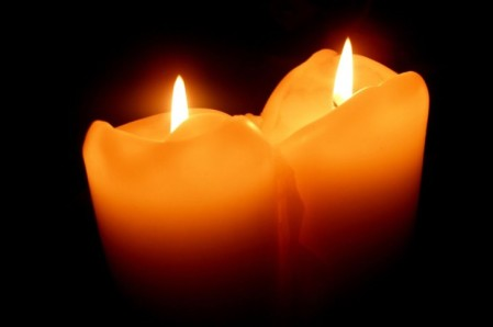 two-burning-candles-730x486