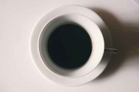 black liquid in white ceramic mug